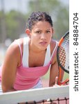 Young female tennis player outdoor playing - stock photo