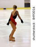 Woman figure skater during competition - stock photo