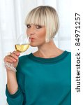 attractive woman with glass of white wine - stock photo
