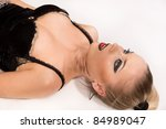 Crime scene simulation: pretty blonde lying on the floor - stock photo