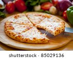 cheese pizza lifted slice | Shutterstock . vector #85029136
