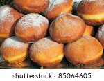 deep fried doughnut  covered with powdered sugar - stock photo