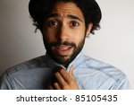 man holding his blouse | Shutterstock . vector #85105435