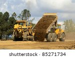 A Large Track Bulldozer And A...