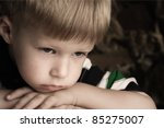 Portrait Of A Little Boy With...