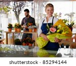 female sales assistant working...   Shutterstock . vector #85294144