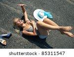 Woman Lying On A Desert Road...