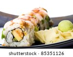 Fresh Shrimp Sushi Rolls at an Asian restaurant with pickled ginger and wasabi. - stock photo