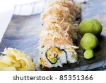 Seafood sushi roll at a Japanese restaurant with pickled ginger and wasabi. - stock photo