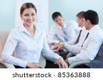 A young girl in the office - stock photo