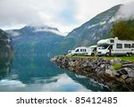 Motorhomes at campsite by the Geirangerfjord in Norway - stock photo