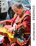 LVIV, UKRAINE - SEPTEMBER 15: Unidentified musician dressed as Ukrainian Cossack plays hand organ and sings Ukrainian national songs at the annual Lviv Book Forum on September 15, 2011 in Lviv, Ukraine - stock photo
