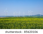 windwheels and a rapeseed field ... | Shutterstock . vector #85620106