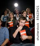 young man at the movie theater... | Shutterstock . vector #85623421