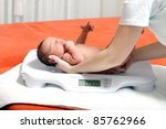 baby boy on weight scale | Shutterstock . vector #85762966