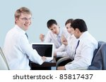 Young businessman with laptop in office - stock photo