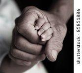 Rough Hand Holding Babyhand