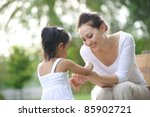 attractive mother and daughter...   Shutterstock . vector #85902721