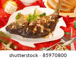 whole carp baked with flaked almonds on christmas table - stock photo