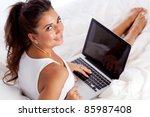 woman with laptop lying in bed | Shutterstock . vector #85987408
