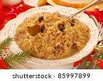 traditional polish sauerkraut (bigos) with mushrooms and plums for christmas - stock photo