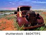 A Rusty Old Pick Up Truck Sits...