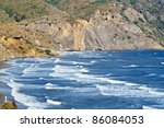 View on beach with big waves - stock photo