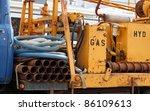 Portable commercial well drilling rig on the back of an old truck - stock photo