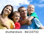 portrait of a cute family on a... | Shutterstock . vector #86110732
