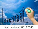 hand drawing graph on blue sky - stock photo