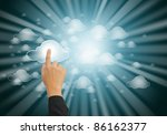 hand pushing the cloud computing button - stock photo