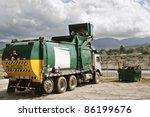 garbage truck caught in action... | Shutterstock . vector #86199676