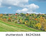 red barns in the distance along ... | Shutterstock . vector #86242666