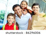 couple with paperbags and their ... | Shutterstock . vector #86296006