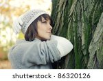 Fashion girl portrait in a hat and gloves, outdoor. - stock photo