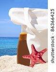 Beach bag, sun cream and starfish on tropical beach - Holiday concept - stock photo