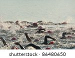 BAYFIELD, WISCONSIN - AUGUST 6: Women Competing in Open Water Swim Race on Lake Superior on August 6, 2011 near Bayfield, Wisconsin - stock photo