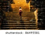 Girl Climbing Up Stairs Of...