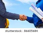 two contractors shake hands... | Shutterstock . vector #86605684