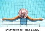 Woman enjoying in swimming pool - stock photo