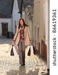 fall elegant woman carrying...   Shutterstock . vector #86619361