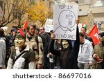TORONTO, CANADA – OCT 15:  Unidentified demonstrators march to Saint James Park in downtown Toronto, for the Toronto version of Occupy Wall Street, Oct. 15 2011. - stock photo