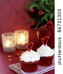 Red velvet cupcakes with vanilla frosting decorated for the Christmas holiday - stock photo