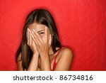 Stock photo playful shy woman hiding face laughing timid cute chinese asian caucasian woman smiling happy 86734816