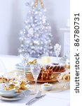 Place setting for Christmas with Christmas tree - stock photo
