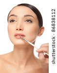 Beauty woman face with brush - stock photo