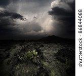 dark clouds over volcanic... | Shutterstock . vector #86844088