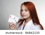 woman holding up playing card... | Shutterstock . vector #86862133