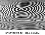 full frame abstract picture showing a piece of wood with black and white painted annual rings - stock photo
