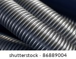 full frame abstract background of showing silver colored grooved tubes - stock photo